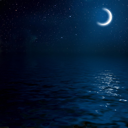 horizon over water: moon on a background star sky reflected in the sea. Elements of this image furnished by NASA