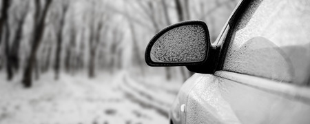 frostily: car in snow on the forest backgrounds Stock Photo