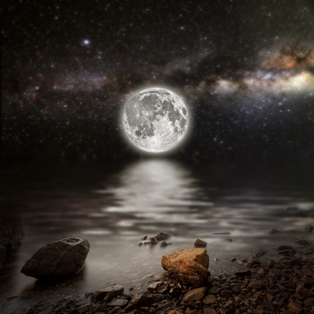 noche y luna: month on a background star sky reflected in the sea.