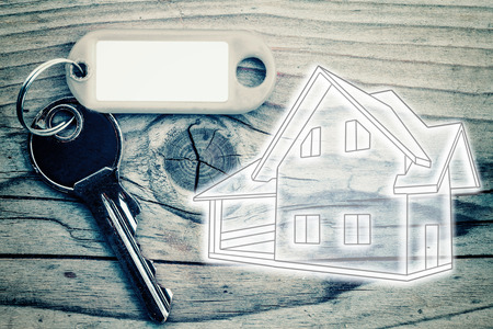 buy house: key on the wood background to buy a house Stock Photo