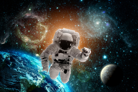 Astronaut flies over the earth in space. Elements of this image furnished by NASA Stock Photo
