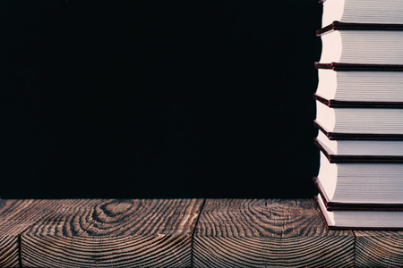 books on the black background of wood