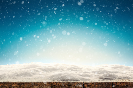 winter Christmas background with snow on the wood Stock Photo