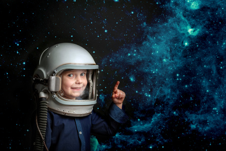 Small child wants to fly an airplane wearing an airplane helmet. Elements of this image furnished by NASA - Image