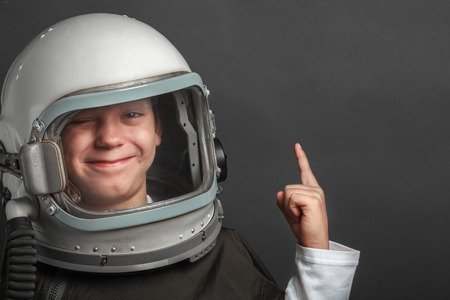 Small child wants to fly an airplane wearing an airplane helmet