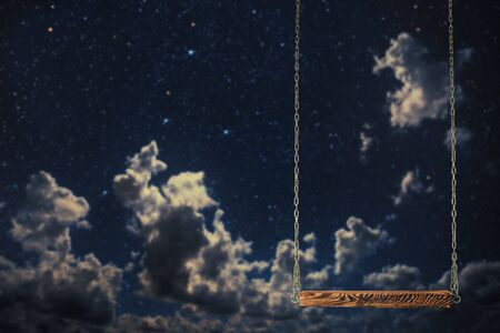 swing on a night sky background Stock Photo