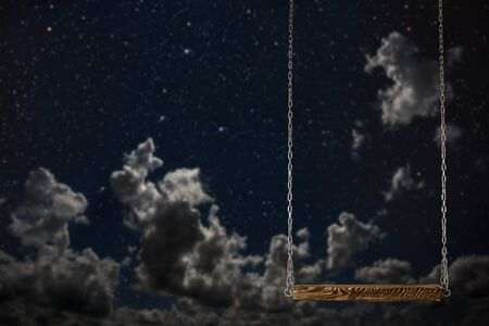 swing on a night sky background Stok Fotoğraf