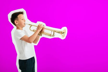 child playing trumpet on turquoise background