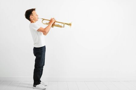 child playing trumpet on white background