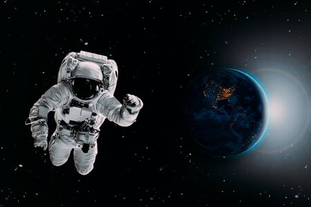 astronaut flies over the earth in space.