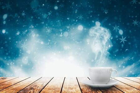 hot coffee on the table on a spring background