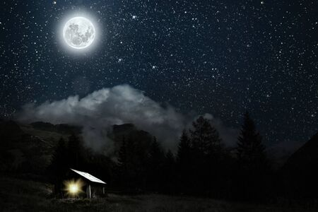 The moon shines over the manger of christmas of Jesus Christ. Elements of this image furnished by NASA