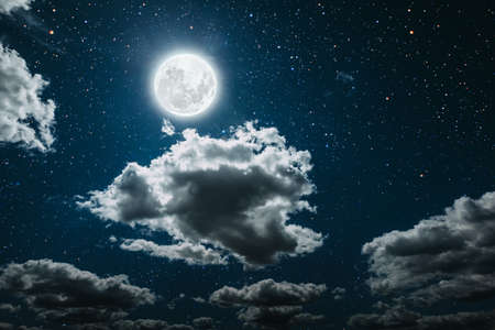 backgrounds night sky with stars and moon and clouds. Standard-Bild