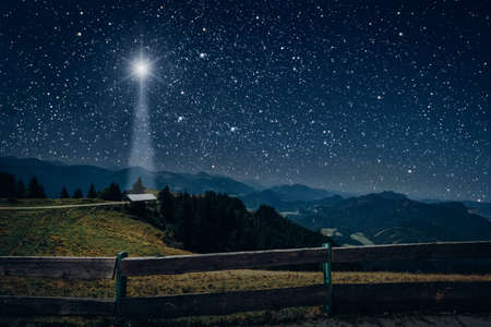 The moon shines over the manger of christmas of Jesus Christ.