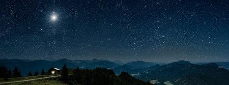 The star shines over the manger of christmas of Jesus Christ. Stock fotó