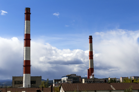 cement chimney: Two chimney-stalks on a background cloudy sky Stock Photo