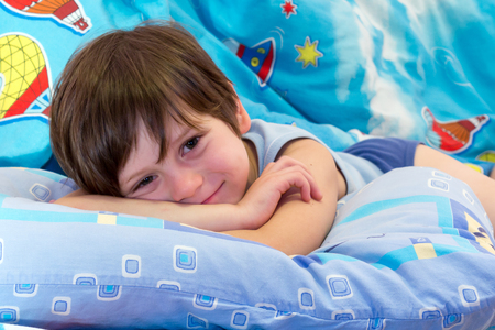 endearing: The child poses before going to bed