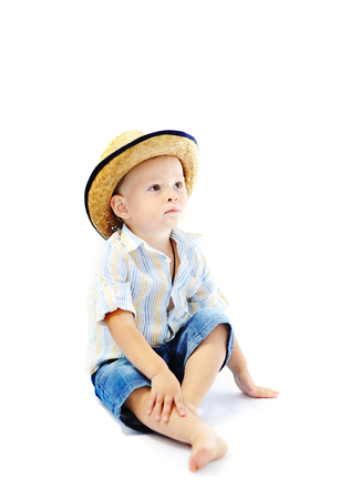 family isolated: baby boy in a straw hat on a white background