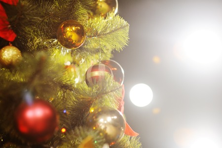 december 25: background with Christmas tree, Christmas decorations and Christmas lights Stock Photo
