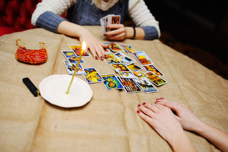 telepathy cards: Divination by the Tarot cards. The fortune teller predicts the fate of the cards Stock Photo