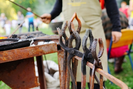 blacksmith: Blacksmith tools on the background of close-up fire