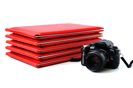 the camera on the background of photo books. graduation photo
