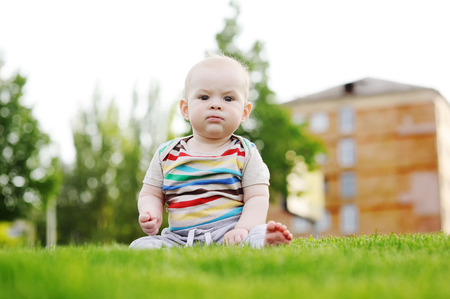 Portrait of a cute baby boy on a grass background Stock Photo