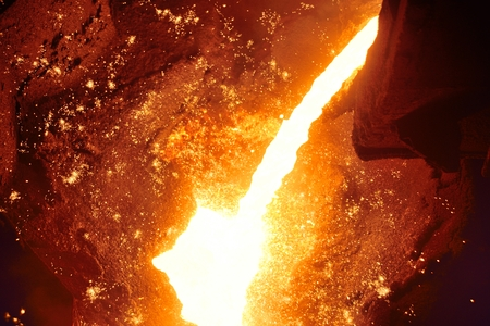 Cast iron and metal at the metallurgical plant. Molten metal in the furnace Stock Photo