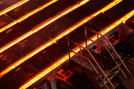 Cast iron or metal in molds on the background of a metallurgical plant Stock Photo