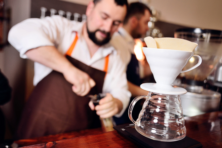Preparing pour over coffee. Modern coffee making concept