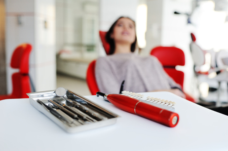 dental tools on a background of the patient in the dental chair Stock Photo