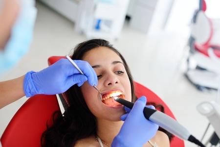 Dentist examines baby girls teeth.Prophylaxis of caries, milk teeth, pediatrics