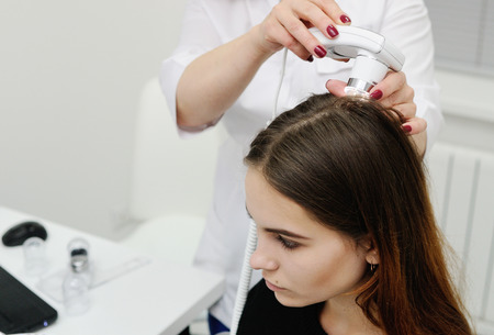 Trihoskopiya - is a method of hair examination using a special device - trihoskopa. Stock Photo