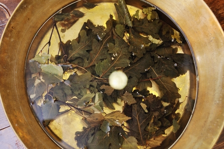 A pedicure tray with oak leaves on a spa salon background