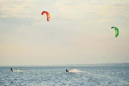 people swim in the sea on a kiteboard or kitesurfing Standard-Bild - 110222660