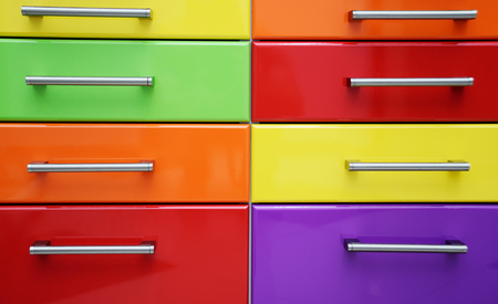 bright multi-colored boxes with metal accessories close - up-background, texture.