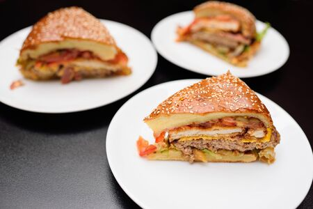Appetizing slices of a large burger or meat pie closeup On the table in the restaurant Stock fotó