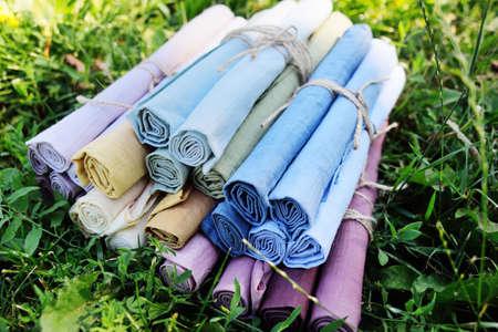 rolls of multicolored fabrics close-up.