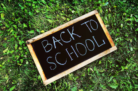 sign in the shape of a blackboard with the words