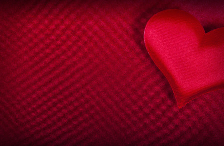 background for Valentines Day red heart on a red background close-up