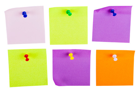reminding: blank forms for reminding pinned colored pins on a white background closeup