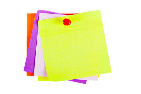 red pushpin: the yellow sheet for notes pierced the red pushpin closeup on white background Stock Photo