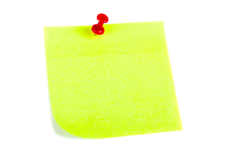 yellow pushpin: the yellow sheet for notes pierced the red pushpin closeup on white background Stock Photo