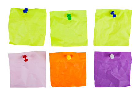six clean crumpled form for reminding pinned colored pins on a white background closeup photo