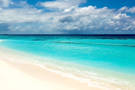wild beach with white sand and turquoise waters of the Caribbean on the Maldivian Bahamas Hawaii