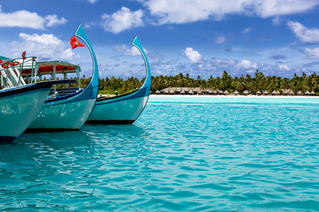boats in a quiet bay of turquoise Hawaii, Caribbean, Maldives