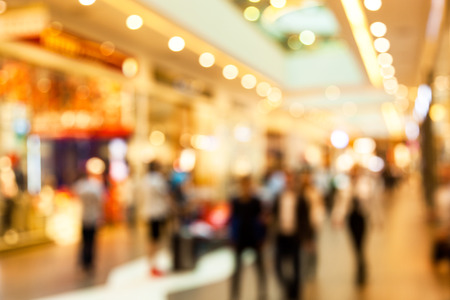 Blurred image of people in shopping mall with bokeh Stock Photo