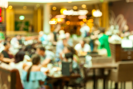 blurred background, photo of people in a restaurant or cafe