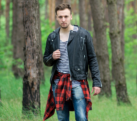 strips away: Trendy guy in a pine forest