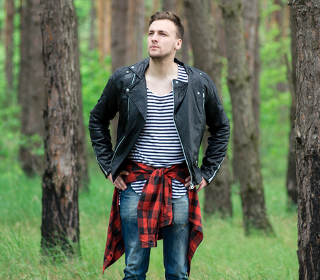 strips away: Trendy guy is resting in a pine forest